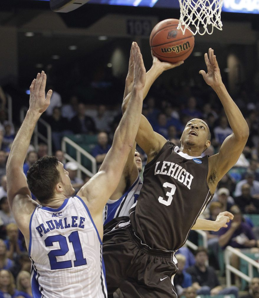 Lehigh's C.J. McCollum (3) shoots over Duke's Miles Plumlee (21) during the first half of an NCAA tournament second-round college basketball game in Greensboro, N.C., Friday, March 16, 2012. (AP Photo/Chuck Burton)