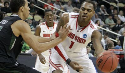 Ohio State's Deshaun Thomas passes around Loyola's Erik Etherly during the second half of an East Regional NCAA tournament first-round college basketball game in Pittsburgh, Thursday, March 15, 2012. ( AP Photo/Gene J. Puskar)