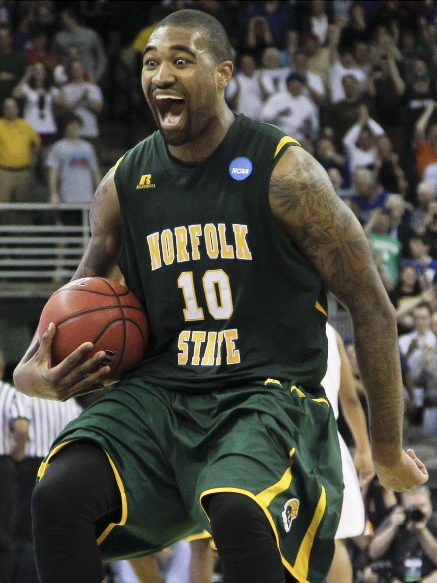 Norfolk State's Kyle O'Quinn celebrates after defeating Missouri 86-84 in the Round of 64 of the NCAA tournament at CenturyLink Center in Omaha, Neb., Friday, March 16, 2012. (AP Photo/Nati Harnik)