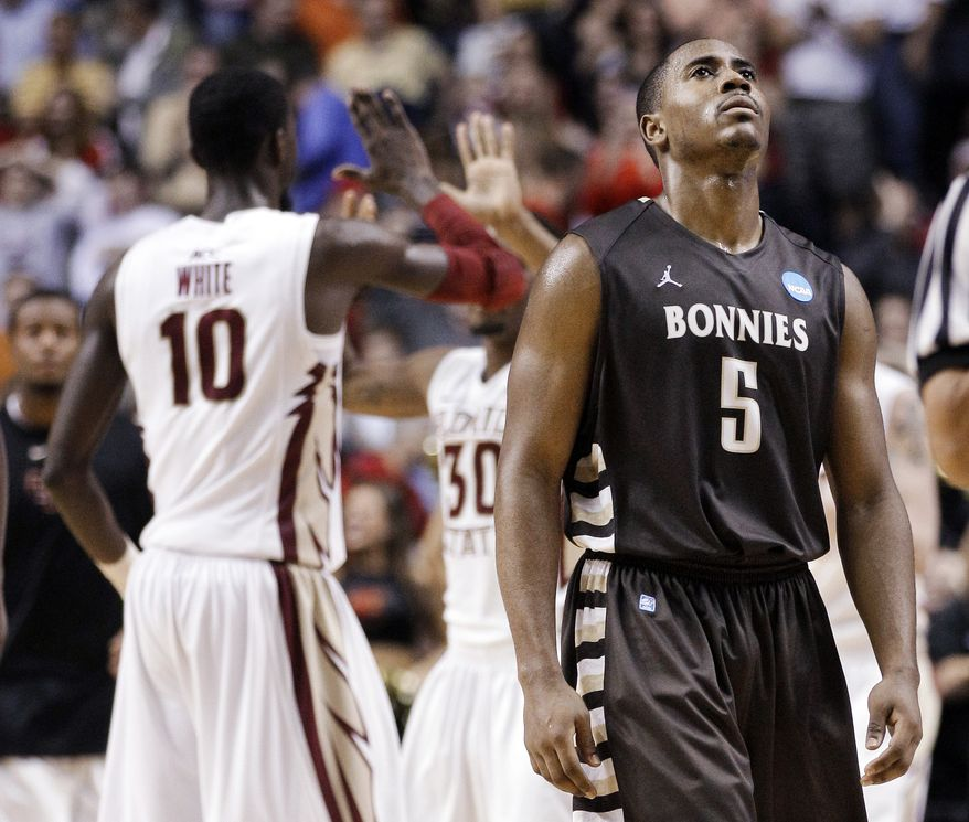 St. Bonaventure guard Jordan Gathers (5) walks to the bench as Florida State's Okaro White (10) and Ian Miller (30) celebrate during a timeout late in the second half of a first-round NCAA college basketball tournament game on Friday, March 16, 2012, in Nashville, Tenn. Florida State won 66-63. (AP Photo/Mark Humphrey)