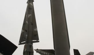 Foreign visitors walk by displays of mock North Korea's Scud-B missile (right) and other South Korean missiles at Korea War Memorial Museum in Seoul on March 16, 2012. (Associated Press)