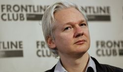 Julian Assange, founder of WikiLeaks listens at a press conference in London, Monday, Feb. 27, 2012. (AP Photo/Kirsty Wigglesworth)
