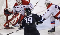 Washington Capitals goaltender Tomas Vokoun makes a save with blueliner Karl Alzer trying to keep Winnipeg Jets' Tobias Enstrom out of the crease during a game in Winnipeg, Manitoba, on Friday, March 16, 2012. (AP Photo/The Canadian Press, John Woods)