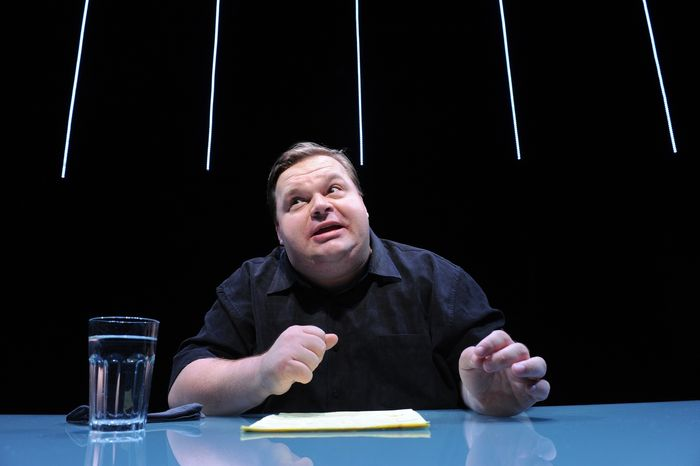"""In this undated image released by the Public Theater, Mike Daisey is shown in a scene from """"The Agony and The Ecstasy of Steve Jobs,"""" in New York. Daisey, whose latest show has been being credited with sparking probes into how Apple's high-tech devices are made, is finding himself under fire for distorting the truth. (AP Photo/The Public Theater, Stan Barouh)"""