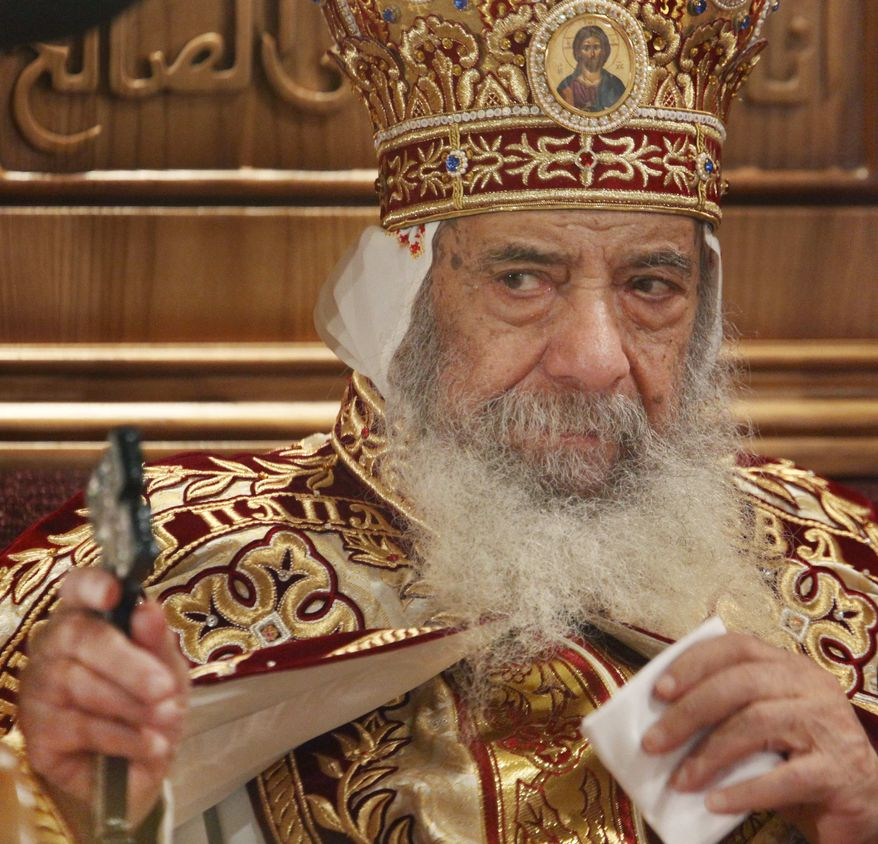 ** FILE ** In this April 18, 2009, file photo, Pope Shenouda III, the head of Egypt's Coptic Orthodox Church, leads a midnight service to celebrate Christ's resurrection, at the Coptic Cathedral in Cairo, Egypt. (AP Photo/Ben Curtis, File)