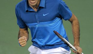 Roger Federer celebrates after winning a point over Rafael Nadal during their semifinal match at the BNP Paribas Open, Saturday, March 17, 2012, in Indian Wells, Calif. Federer won 6-3, 6-4. (AP Photo/Mark J. Terrill)