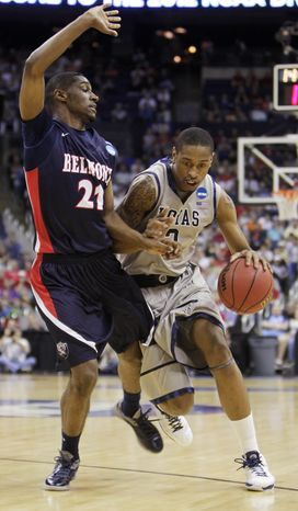 Georgetown's Greg Whittington, right, drives to the basket in an NCAA college basketball tournament second-round game on Friday, March 16, 2012, in Columbus, Ohio. Georgetown defeated Belmont 74-59. (AP Photo/Jay LaPrete)