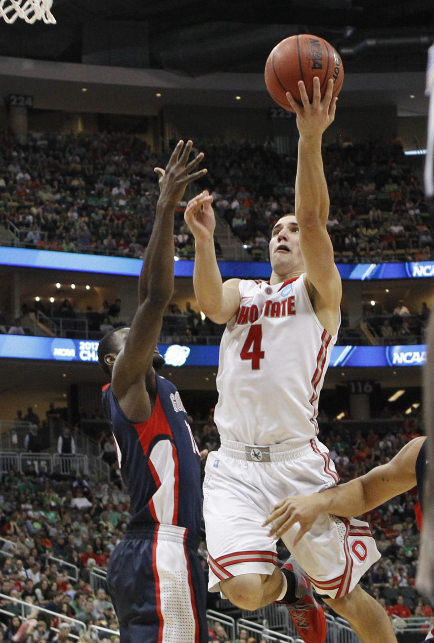 Ohio State's Aaron Craft (4) puts up a shot in front of Gonzaga's Guy Landry Edi in the second half of an NCAA tournament third-round game on Saturday, March 17, 2012 in Pittsburgh. Ohio State won 73-66. (AP Photo/Keith Srakocic)