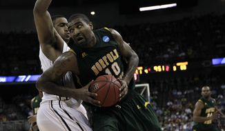 Norfolk State's Kyle O'Quinn is defended by Missouri's Steve Moore in their NCAA tournament second-round college basketball game at CenturyLink Center in Omaha, Neb., Friday, March 16, 2012. Norfolk State won 86-84, and O'Quinn had 26 points and 14 rebounds. (AP Photo/Nati Harnik)