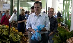 Republican presidential candidate, former Massachusetts Gov. Mitt Romney shops for produce during a campaign stop on Saturday, March 17, 2012, in Bayamon, Puerto Rico. (AP Photo/Evan Vucci)