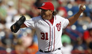 Washington Nationals pitcher John Lannan throws against the New York Yankees during a spring training game in Viera, Fla., Thursday, March 15, 2012. (AP Photo/Paul Sancya)