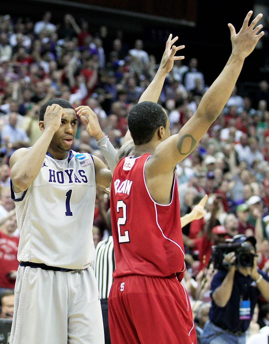 Georgetown's Hollis Thompson is in disbelief after 11th-seeded N.C. State upset the third-seeded Hoyas 66-63 in the third round of the NCAA tournament. (Associated Press)