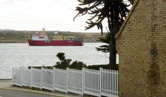 Oil wealth, if it occurs, stands to change the way of life on the Falklands. A survey ship (top) sails in Stanley Harbor before leaving on a scientific mission to study the undersea topography for offshore oil exploration. Penguins gather on the coast of Murrell Farm near the northeastern corner of the islands. (Associated Press)