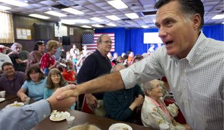 Republican presidential candidate Mitt Romney presses the flesh at a campaign stop on Sunday, March 18, 2012, in Moline, Ill. (Associated Press)