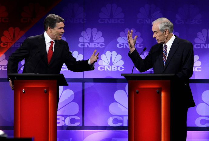 Texas Gov. Rick Perry and Rep. Ron Paul, of Texas, go head to head during the Republican presidential debate at Oakland University in Auburn Hills, Mich., o
