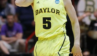 Baylor guard Brady Heslip (5) gestures after hitting a three-point basket during the first half of an NCAA tournament third-round college basketball game against Colorado, Saturday, March 17, 2012, in Albuquerque, N.M. Baylor won 80-63. (AP Photo/Matt York)
