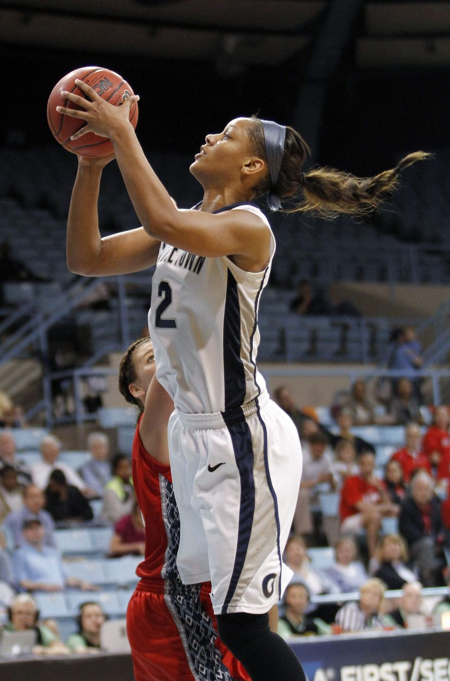 Georgetown's forward Tia Magee drives to the basket against Fresno State during the second half of NCAA tournament first-round game in Chapel Hill, N.C., Sunday, March 18, 2012. Georgetown won 61-56. (AP Photo/Jim R. Bounds)