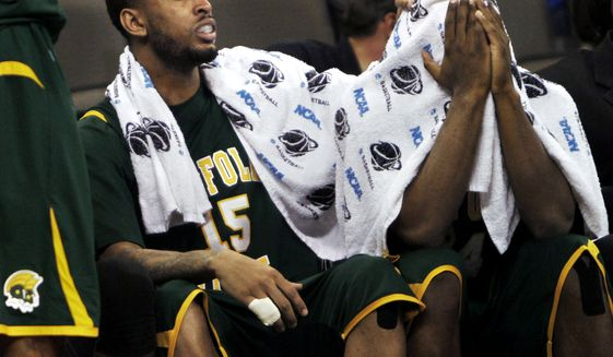Norfolk State's Rodney McCauley, left, comforts teammate Brandon Wheeless after the Spartans lost to Florida in their NCAA tournament third-round college basketball game in Omaha, Neb. Florida won 84-50. (AP Photo/The Virginian-Pilot, Stephen M. Katz)