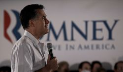 Republican presidential candidate Mitt Romney listens to a question during a campaign stop on Saturday, March 17, 2012, in Collinsville, Ill. (AP Photo/Charlie Riedel)