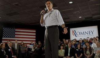 Former Massachusetts Gov. Mitt Romney addresses a crowd in Collinsville, Ill., during a stop on his presidential campaign on Saturday, March 17, 2012. (AP Photo/Charlie Riedel)