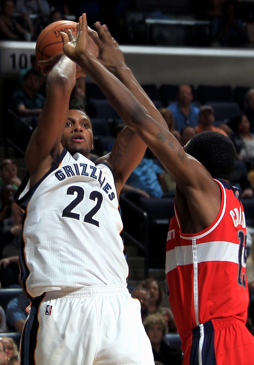Memphis Grizzlies forward Rudy Gay shoots over the defense of Washington Wizards guard Jordan Crawford in the second half on Sunday, March 18, 2012, in Memphis, Tenn. Gay led the scoring with 27 points for the Grizzlies. The Grizzlies defeated the Wizards 97-92. (AP Photo/Nikki Boertman)