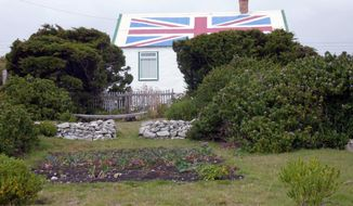 **FILE** Loyalty to Britain is displayed on the home of the mother of Jan Cheek, one of the eight members of the Falkland Islands Legislative Assembly, in this March 13, 2012, file photo. (Associated Press)