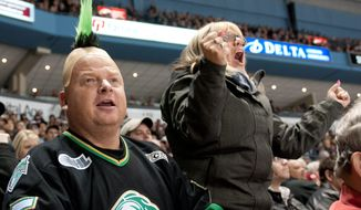 London Knights hockey fans Jim Stevens, left, his wife Yvonne Stevens, react to a missed scoring opportunity while watching their hometown junior hockey club play against the visiting Oshawa Generals at the John Labatt Centre in London,Ontario, Canada on Friday March 2, 2012. The long-time fans have been season ticket holders for the past 7 years. (Craig Glover/Special to The Washington Times)