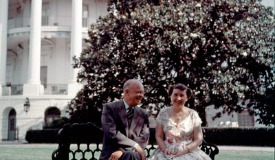 President Eisenhower and first lady Mamie Eisenhower chat on the South Lawn with the Truman balcony of the White House visible behind them. (Associated Press)