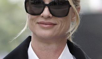 "FILE - In this March 15, 2012 file photo, Nicollette Sheridan arrives at court in Los Angeles. A judge declared a mistrial Monday in Nicollette Sheridan's wrongful termination trial after the jury deadlocked, leaving an unresolved finale to a two-week trial that focused on the behind-the-scenes intrigue and personalities of TV's ""Desperate Housewives."" (AP Photo/Nick Ut)"