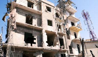 "This photo released by the Syrian official news agency SANA shows a damaged building after an explosion ripped through a residential neighborhood in the northern Syrian city of Aleppo on March 18, 2012. The state news agency said it was a ""terrorist bombing."" (Associated Press/SANA)"