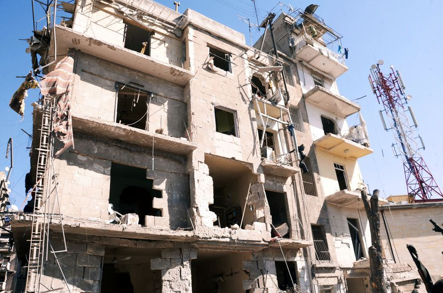 """This photo released by the Syrian official news agency SANA shows a damaged building after an explosion ripped through a residential neighborhood in the northern Syrian city of Aleppo on March 18, 2012. The state news agency said it was a """"terrorist bombing."""" (Associated Press/SANA)"""