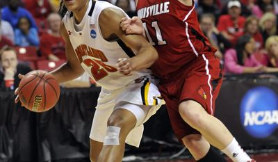 Maryland's Alyssa Thomas (25) drives to the basket as Louisville's Becky Burke defends during the first half of an NCAA tournament second-round women's college basketball game, Monday, March 19, 2012, in College Park, Md. (AP Photo/Gail Burton)