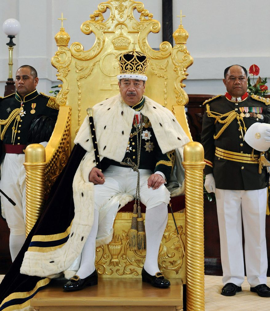 ** FILE ** Tongan King George Tupou V, who championed a more democratic system of government in his Pacific island nation, sits on the throne in Nuku'aloka, Tonga, in August 2008. (AP Photo/New Zealand Herald, Glenn Jeffrey, File)