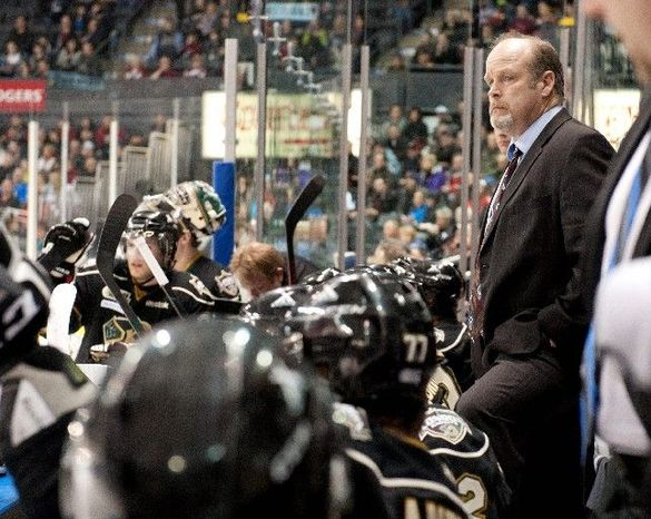 Mark Hunter has called the shots on the bench for the Ontario Hockey League's London Knights since his brother, Dale, was hired to coach the Capitals on Nov. 28. The Knights have gone 29-13 in Dale Hunter's absence. (Craig Glover/Special to The Washington Times)
