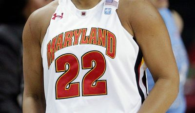 Maryland guard Kim Rodgers reacts after scoring a 3-pointer in the first half of an NCAA college basketball game against North Carolina in College Park, Md., Friday, Feb. 24, 2012. (AP Photo/Patrick Semansky)
