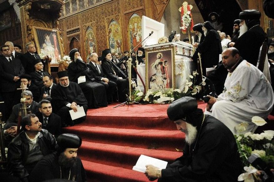 ASSOCIATED PRESS PHOTOGRAPHS Egyptian senior clerics pray at St. Mark's Cathedral in Cairo during the funeral Mass for Pope Shenouda III, who headed the Coptic Orthodox Church for 40 years.