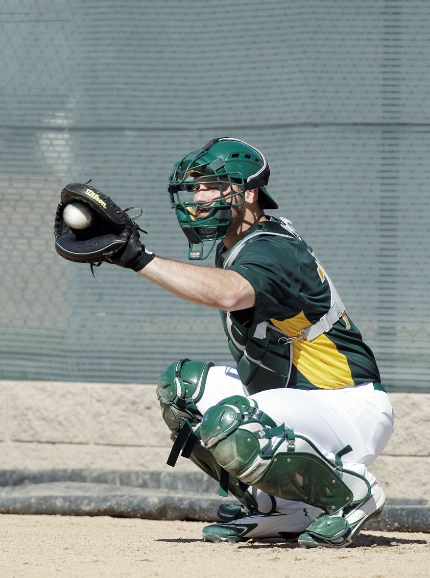 Oakland Athletics' Derek Norris during a spring training baseball workout Monday, Feb. 27, 2012 in Phoenix. (AP Photo/Darron Cummings)