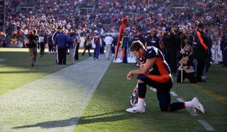 ** FILE ** In this Dec. 11, 2011 file photo, Denver Broncos quarterback Tim Tebow prays in the end zone before the start of an NFL game against the Chicago Bears, in Denver. Peyton Manning has joined the Broncos. The addition of Manning could well lead to Denver trading Tebow, even though the popular QB energized the Broncos in leading them to the playoffs last season despite some uneven play. (AP Photo/Julie Jacobson, File)
