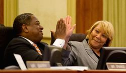 ** FILE ** D.C. Council members Vincent B. Orange and Yvette M. Alexander. (Andrew Harnik/The Washington Times)