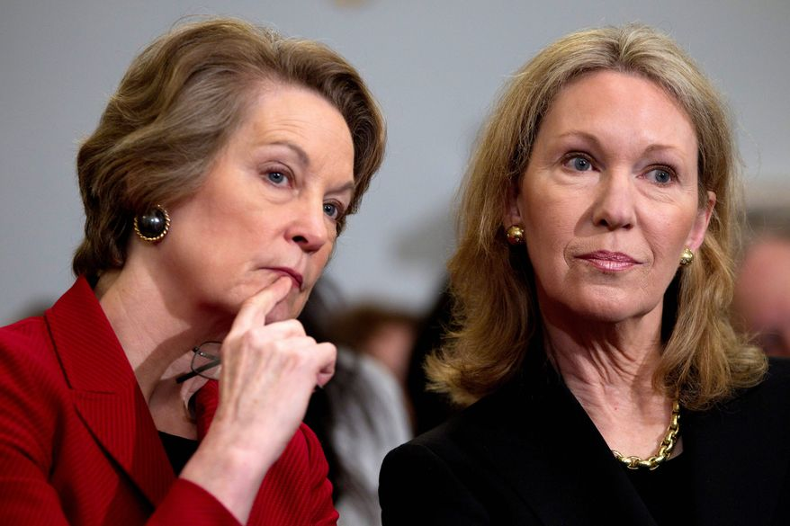 Susan Eisenhower (left) and Anne Eisenhower, granddaughters of President Eisenhower, listen to testimony on Capitol Hill on Tuesday during the House subcommittee on national parks, forests and public lands hearing on the proposed Dwight D. Eisenhower Memorial on the National Mall. (Associated Press)