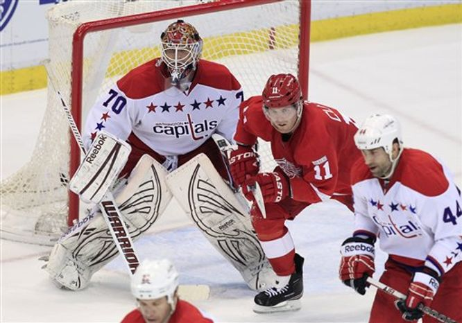 Braden Holtby played through cramping in the third period Monday night but still managed to beat the Red Wings. (Associated Press)
