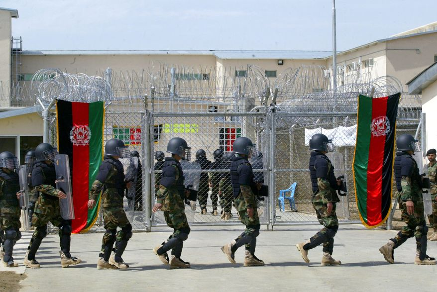 ** FILE ** Afghan prison security personnel march at the opening ceremony for the newly refurbished Pol-i-Charki prison in Kabul, Afghanistan, in March 2007. (AP Photo/Musadeq Sadeq, File)