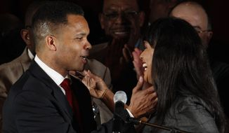 Then-Rep. Jesse L. Jackson Jr., Illinois Democrat, and his wife, then-Chicago Alderman Sandi Jackson, embrace at his election-night party on Tuesday, March 20, 2012, in Chicago after his Democratic primary win over former Rep. Debbie Halvorson in Illinois' 2nd District. (AP Photo/M. Spencer Green) ** FILE **