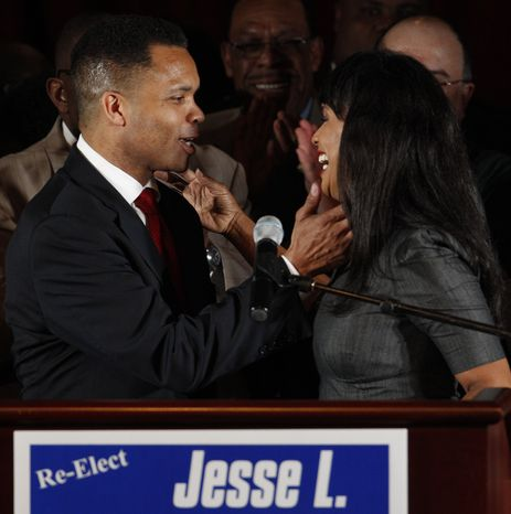 ** FILE ** Rep. Jesse L. Jackson Jr., Illinois Democrat, and his wife, Chicago Alderman Sandi Jackson, embrace at his election-night party on Tuesday, March 20, 2012, in Chicago after his Democratic primary win over former Rep. Debbie Halvorson in Illinois' 2nd District. Mr. Jackson resigned his congr
