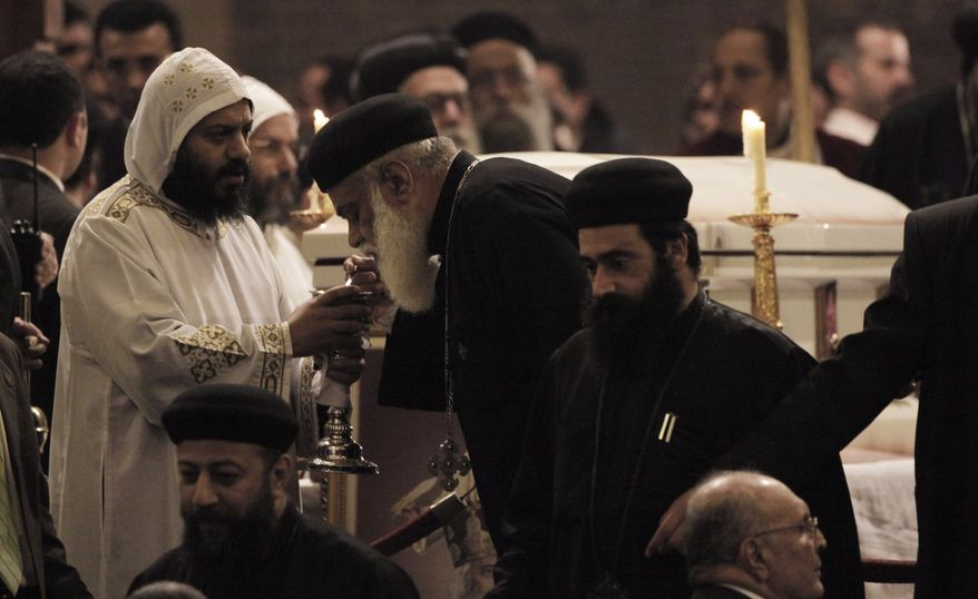 Senior clerics gather to pay their final respects during the funeral Mass of Pope Shenouda III at the Coptic Orthodox cathedral in Cairo on Tuesday, March 20, 2012. (AP Photo/Nasser Nasser)