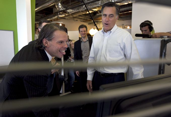 Republican presidential candidate, former Massachusetts Gov. Mitt Romney, right, looks at a computer screen with Google employee Ted Souder, Tuesday, March 20, 2012, at the Chicago Google headquarters, in Chicago. (AP Photo/Steven Senne)