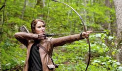 "Jennifer Lawrence portrays Katniss Everdeen, a tough ""tribute"" from an outlying district who is brought to the Capitol to fight for her life in ""The Hunger Games."" (Lionsgate via Associated Press)"