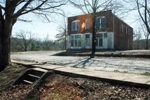 "Scenes for ""The Hunger Games"" movie were shot at the old company store at Henry River Mill Village in Hildebran, N.C. The store became the Mellark family bakery in District 12 for the movie. (VisitNC.com via Associated Press)"