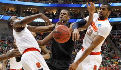 C.J. Fair (left) and James Southerland gang up on Kansas State's Jordan Henriquez in Syracuse's opening victory. The Orange play Wisconsin at 7:15 p.m. Thursday. (Associated Press)