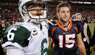 Quarterback Tim Tebow (right) will join fellow QB Mark Sanchez in New York after the Denver Broncos and Jets completed a trade Wednesday night. (Associated Press)
